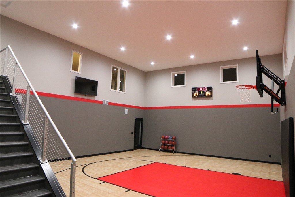 Eden Prairie_Indoor Basketball Court Featuring SnapSports Revolution Tuffshield Light Maple and Red athletic flooring tiles