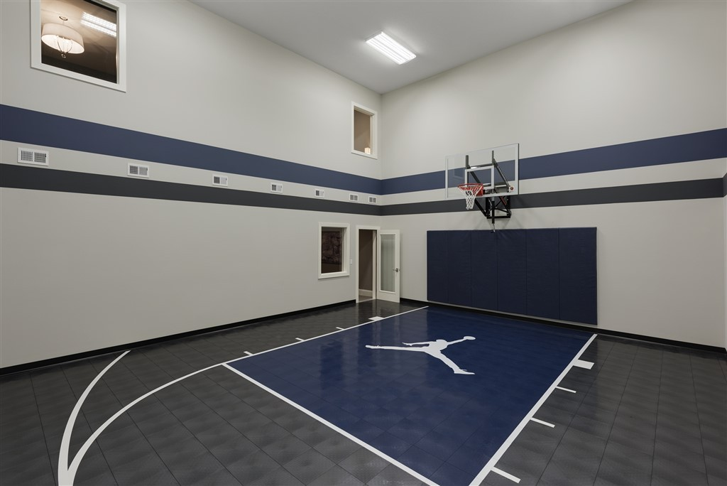 Millz House custom basketball court utilizing SnapSports athletic tile flooring