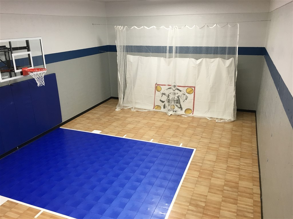 Millz House installed indoor basketball court with option for hockey utilizing SnapSports athletic flooring