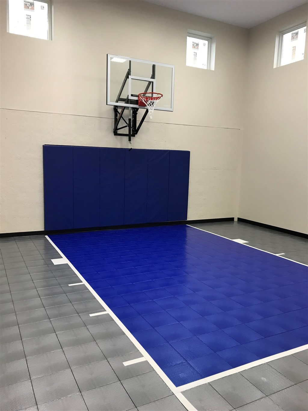 Millz House installed this indoor game court utilizing SnapSports athletic flooring tiles