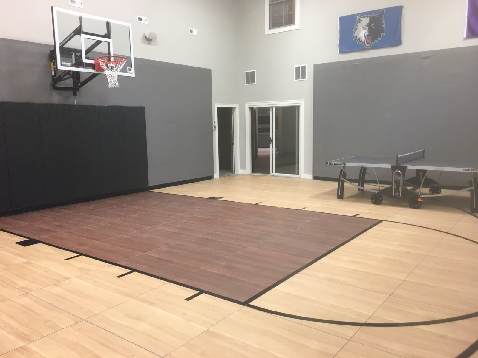 Indoor basketball court in Edina MN with SnapSports flooring in light and dark maple