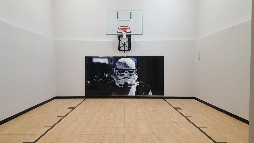 Millz House / SnapSports MN installed indoor basketball court featuring Star Walls Wall Pad