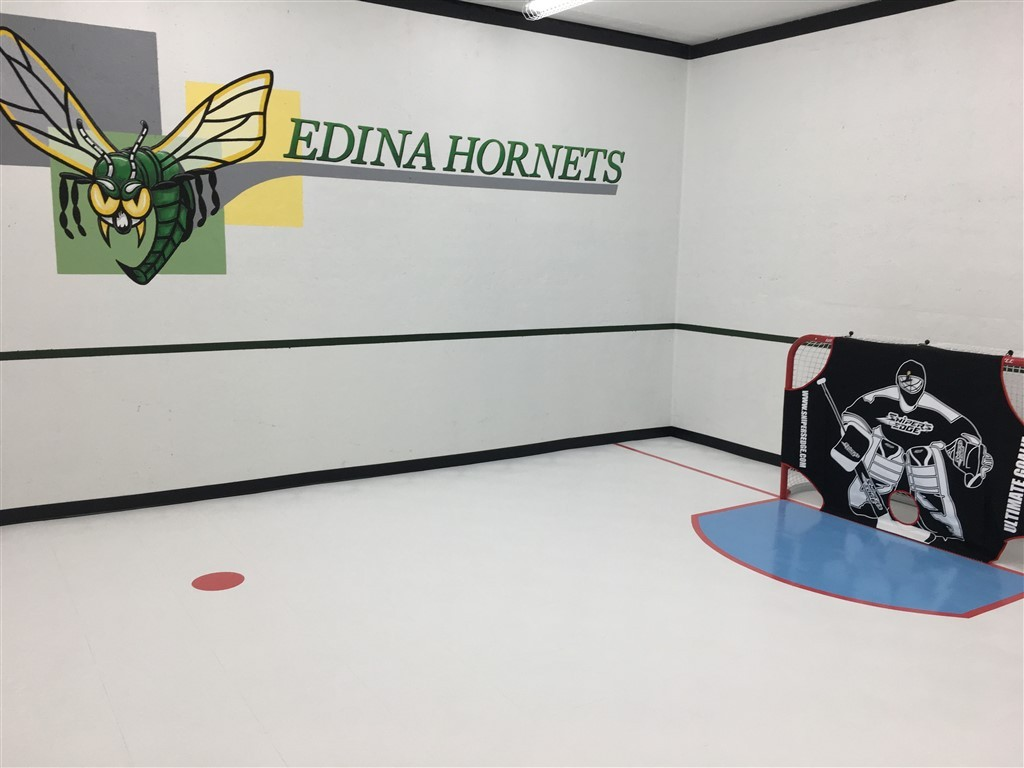 Customized Indoor Hockey Court featuring SnapSports hockey athletic tiles installed by Millz House