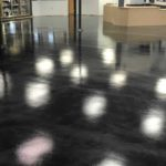 Millz House recently installed a metallic floor coating at the Braham Liquor Store