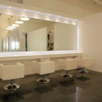 Metallic floor coating installed in commercial hair salon