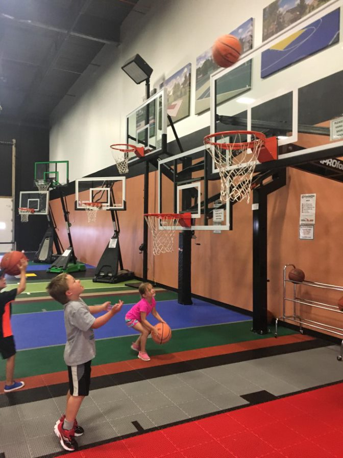 Kids playing basketball at the Millz House Showroom in Apple Valley