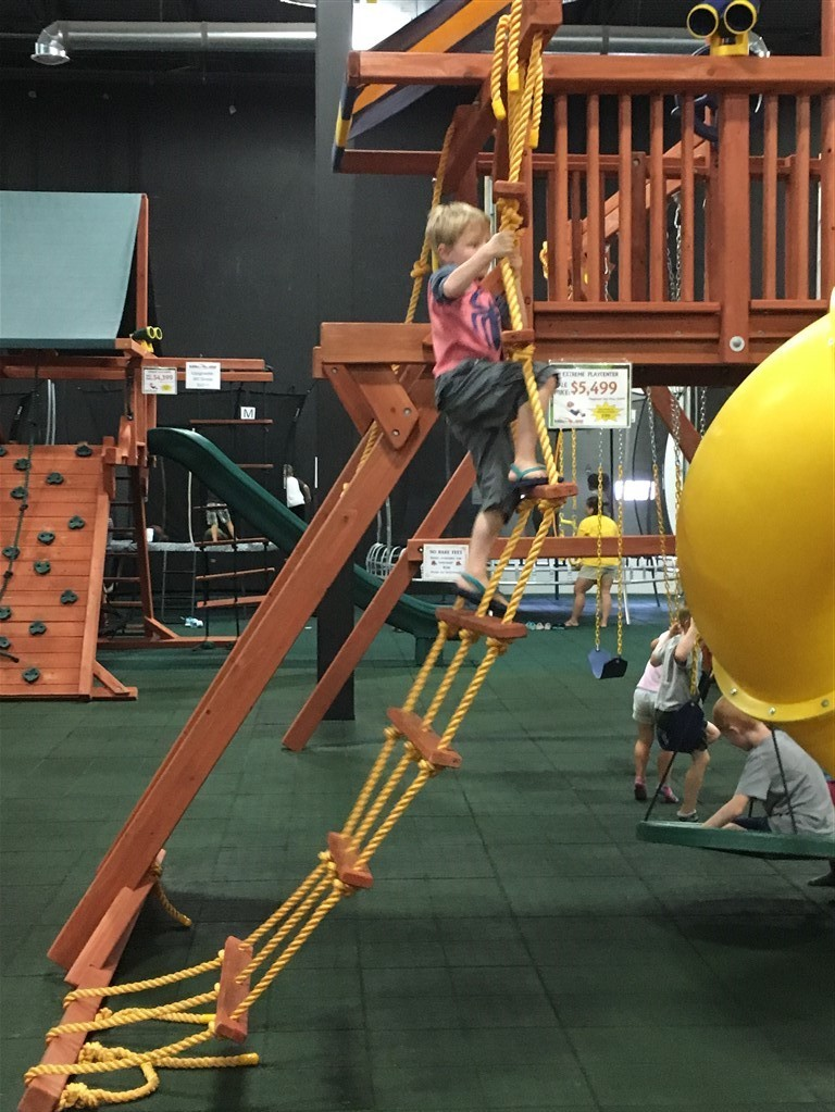 Children playing at Millz House Showroom in Apple Valley